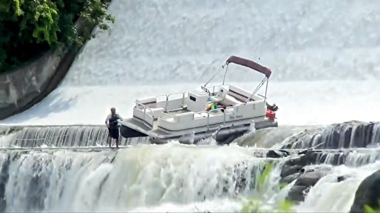Pontoon Boat Tumbles Over Dam, Lands Upright, Crew Is Okay (Video)