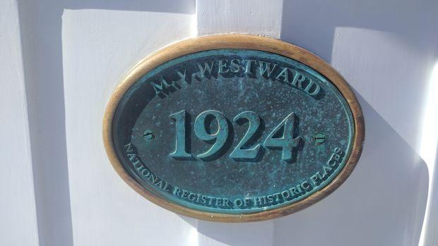 Placard designating the MV Westward as a historic place, designated by the National Parks Service.
