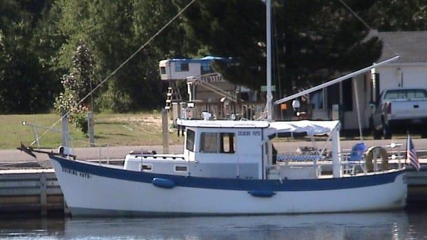 "Before: Shining Path in her previous incarnation—original ""sail option"" still intact—docked on the South Shore of Lake Superior's Keweenaw Peninsula. (Photo courtesy John Hulkoff)"