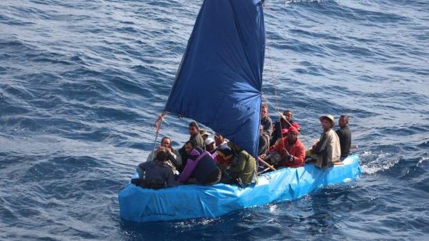Cuban migrants sail a rustic vessel south of Key West, Florida, Jan. 1, 2015. The Coast Guard Cutter Mohawk interdicted the 24 Cuban migrants and were later repatriated to Bahia de Cabañas, Cuba. U.S. Coast Guard photo.