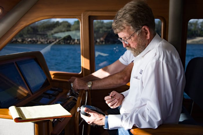 Capt. Pike testing the sound levels and running speeds of the new Grand Banks 60.