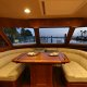 A close up of the u-shaped dinette aboard the Marlow 49 Explorer.