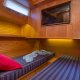 Bunks in guest stateroom separate into two twin berths.