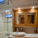 The master head features a separate shower and small tub.