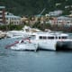 Boats damaged by Hurricane Irma sit anchored or beached in the Inner Harbour of Road Town on Tortola.