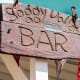 The original Soggy Dollar Bar sign (or at least most of it) was found hundreds of yards down the beach buried in the sand and debris after Hurricane Irma.