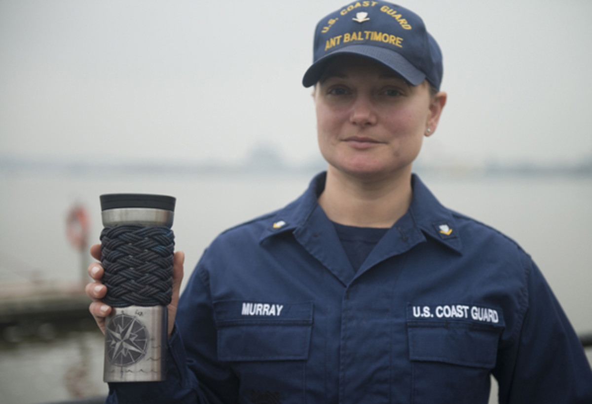 Petty Officer 3rd Class Elizabeth Murray, a boatswain's mate at Aids to Navigation Team Baltimore, poses with the travel mug she tied a turk's head on to. (US Coast Guard photo by Petty Officer 2nd Class David Marin)