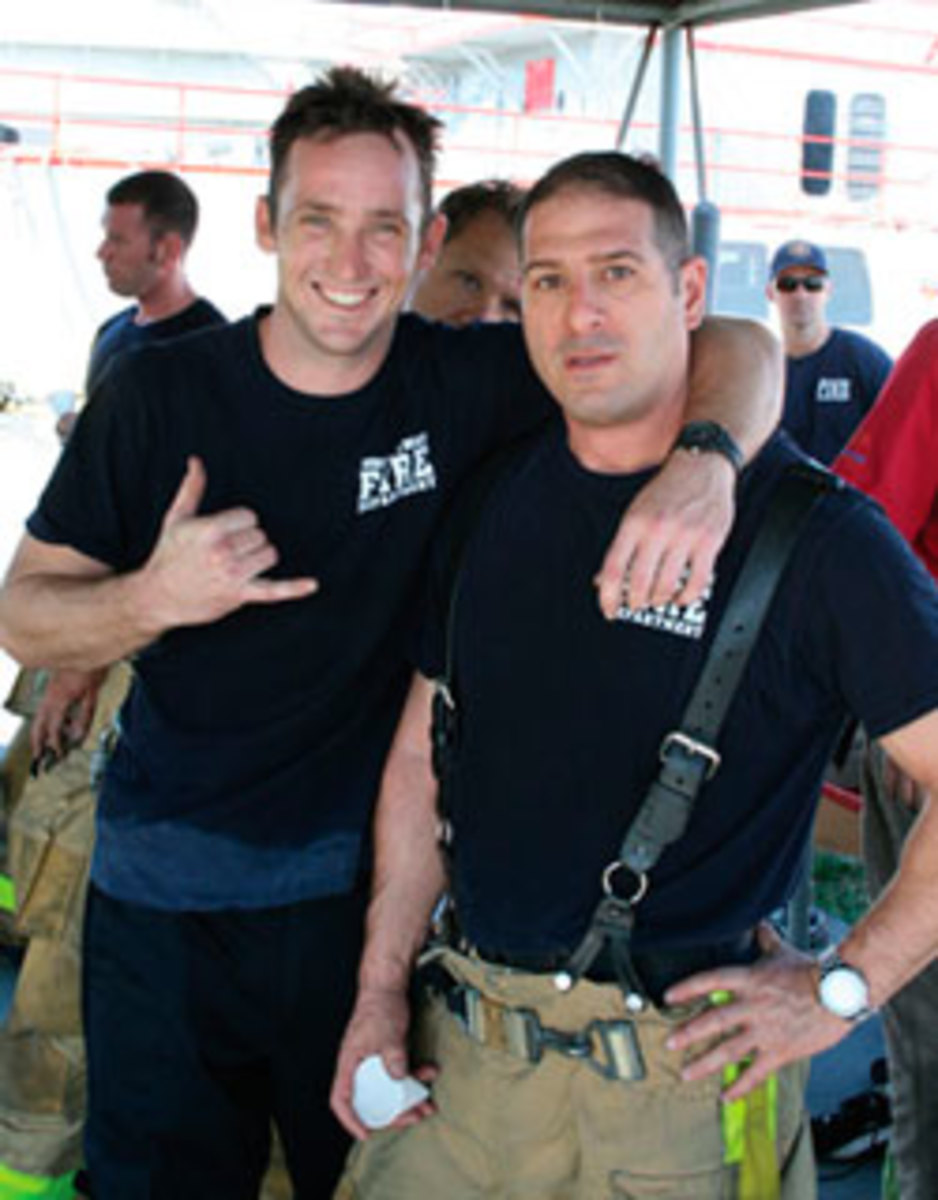 Two firefighters (Brandon Bartlett, left, and Gary Dolins) take a breather post exercise.