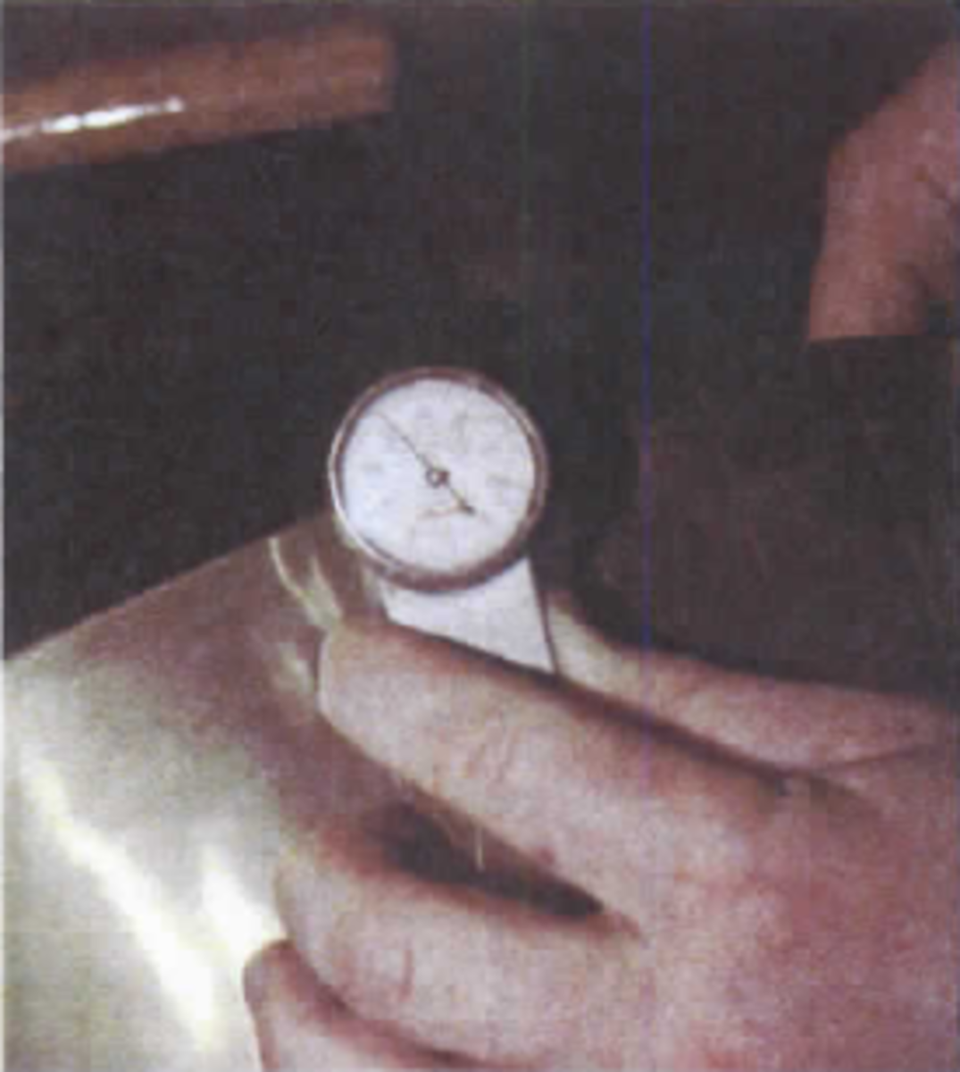 Cup is hand measured using a dial indicator.