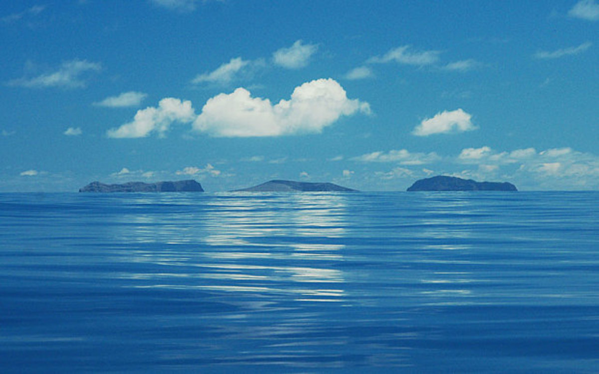 Two pre-existing islands flank the volcanic island on either side.