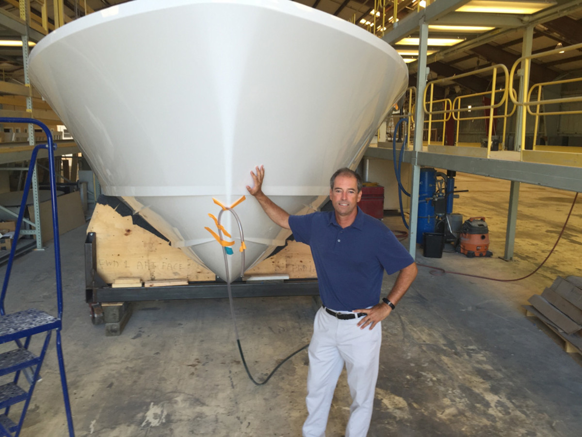 Truslow posing in front of the soon-to-be-launched Bertram 35.