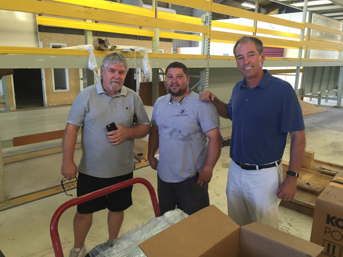 Truslow (right) is shown with materials manager Wayne DeLoach (left) and mechanical leader Alex Cadiz.