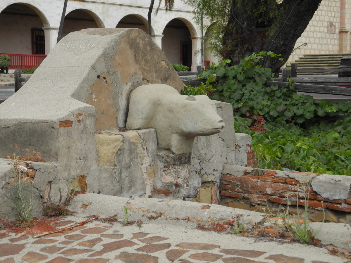 The stone bear at the entrance of the Spanish Mission's Lavanderia.