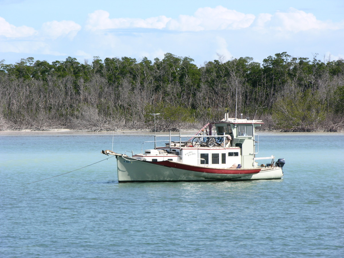 "This character boat occupies an area outside the Boot Key Harbor, where anchoring is still allowed. Anchored boats had once housed an ""outlaw"" element in the harbor."