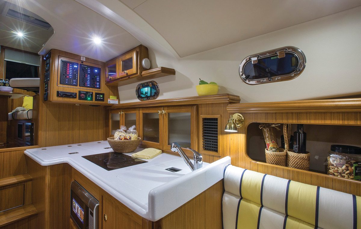 The galley feels spacious despite the yacht's 32-foot LOA and flows nicely into the saloon above.