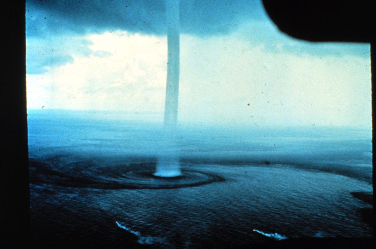 Waterspouts are spinning columns of rising moist air that typically form over warm water. Waterspouts can be as dangerous as tornadoes and can feature wind speeds of more than 120mph. They are common in southern waters, particularly in summer, and happen when water is warm and the air aloft is cool. The above image was taken in 1969 from an aircraft off the Florida Keys, a location that is arguably the hottest spot for waterspouts in the world with hundreds forming each year.