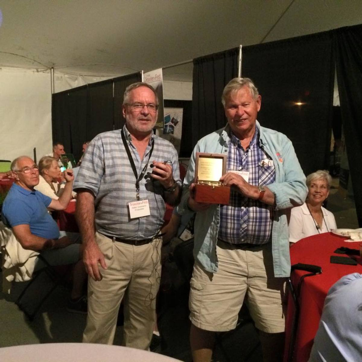 Bob Smith (right) was recently saluted at TrawlerFest-Riviera Beach for attending every TrawlerFest to date.