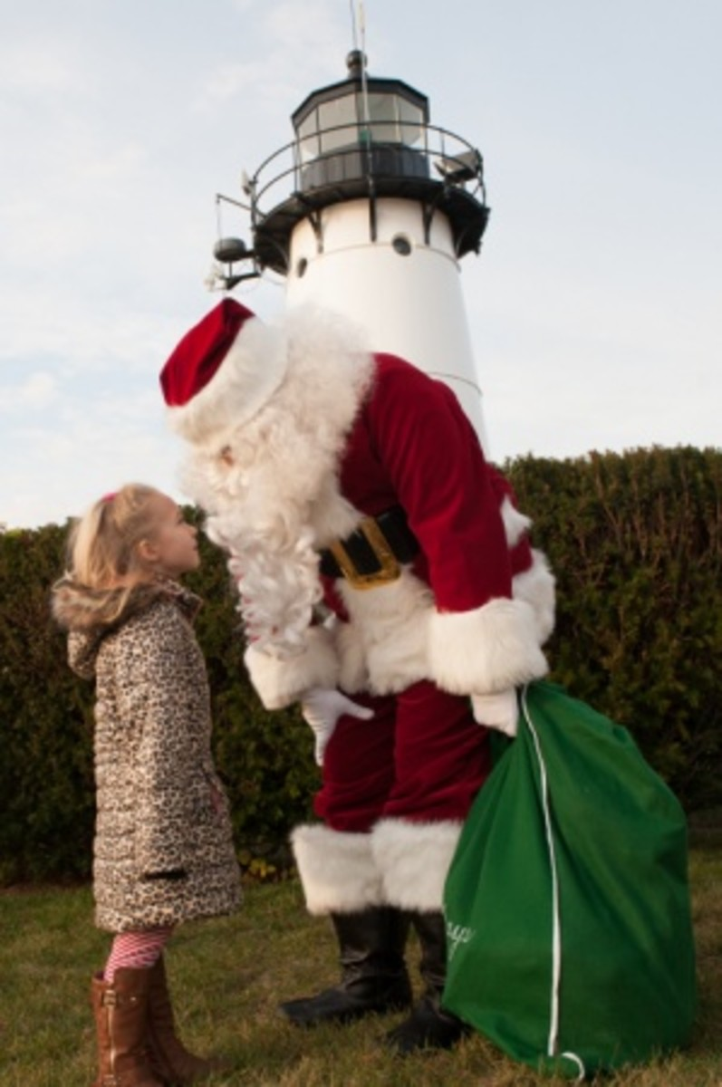 Coast Guard members from Civil Engineering Unit Providence and their family members attend a Friends of Flying Santa event at Warwick Lighthouse, Rhode Island, Sunday, Dec. 13, 2015. Friends of Flying Santa is a nonprofit organization that flies Santa by helicopter to locations across New England delivering gifts to the children of Coast Guard members. (U.S. Coast Guard photo by Petty Officer 3rd Class Andrew Barresi)