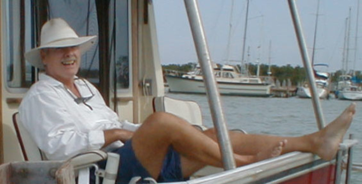 "Bruce Van Sant relaxes on his Schucker 44 trawler. He sold it about six years ago and ""swallowed the anchor."" He now lives in Puerto Plata in the Dominican Republic."