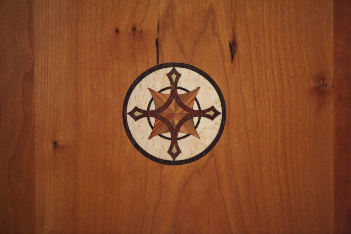 III designed and fabricated a 30+ piece compass rose that appears thought the interior spaces.