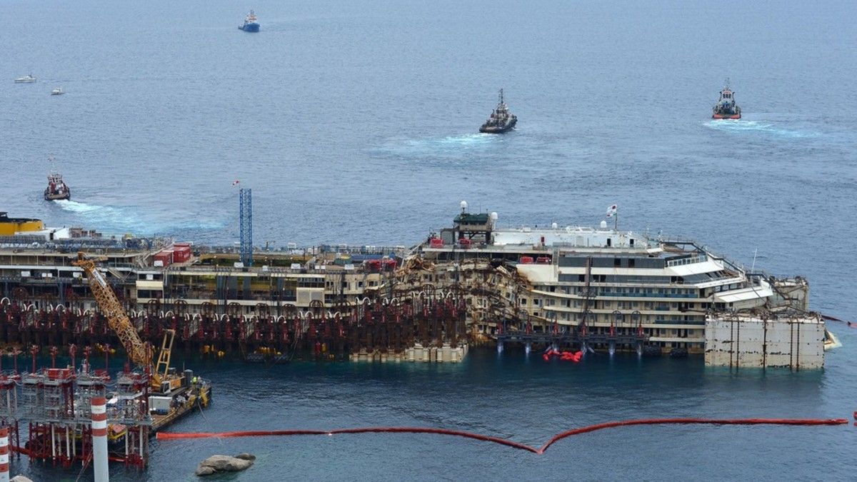 Tug boats pulls the wreck of the Costa Concordia cruise ship during an operation to refloat the boat on July 14, 2014 off the Giglio Island. (VINCENZO PINTO/AFP/GETTY IMAGES)