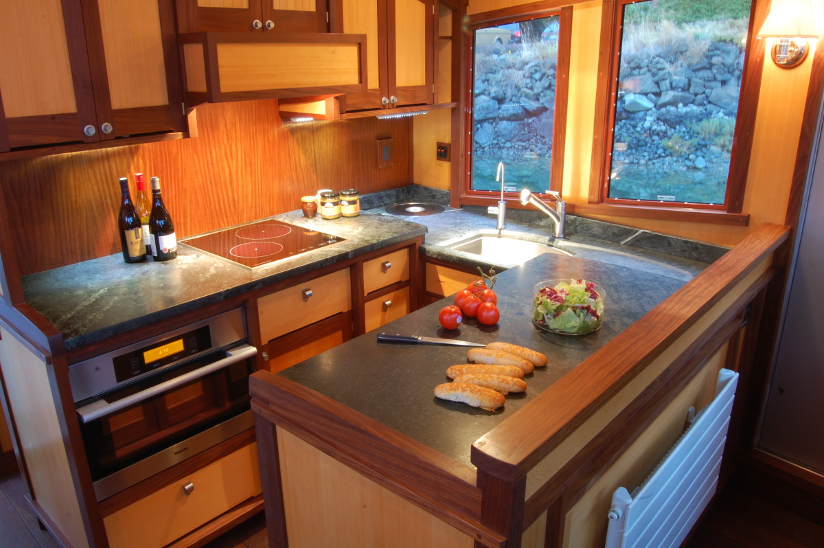 Soapstone countertops and brushed-nickel hardware enrich the well-equipped galley.