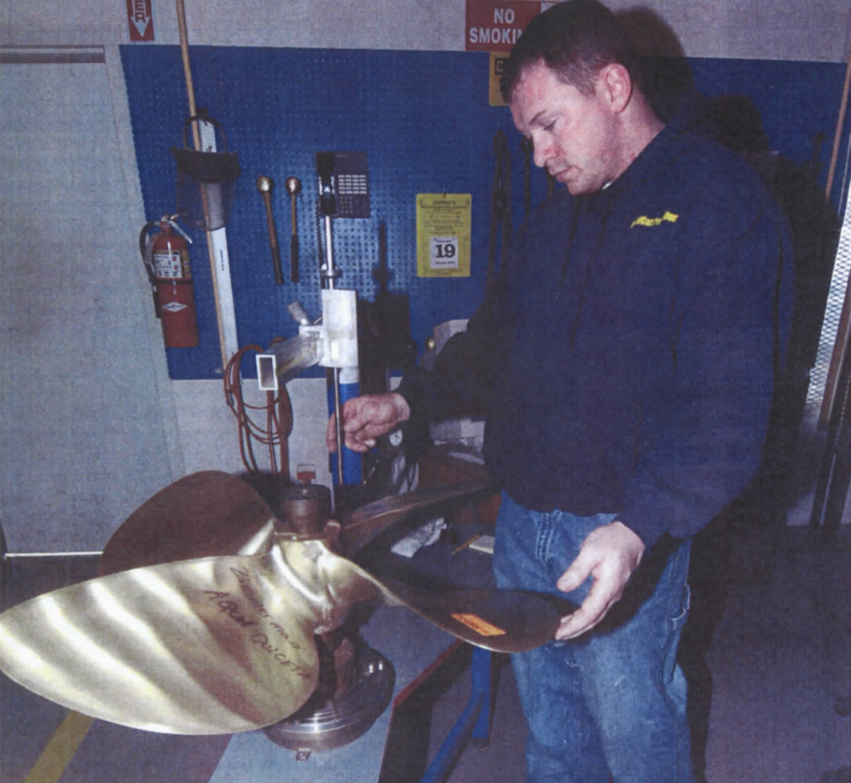 Wildcat Propellers repair technician Troy Erb measures a propeller using the Prop Scan system.