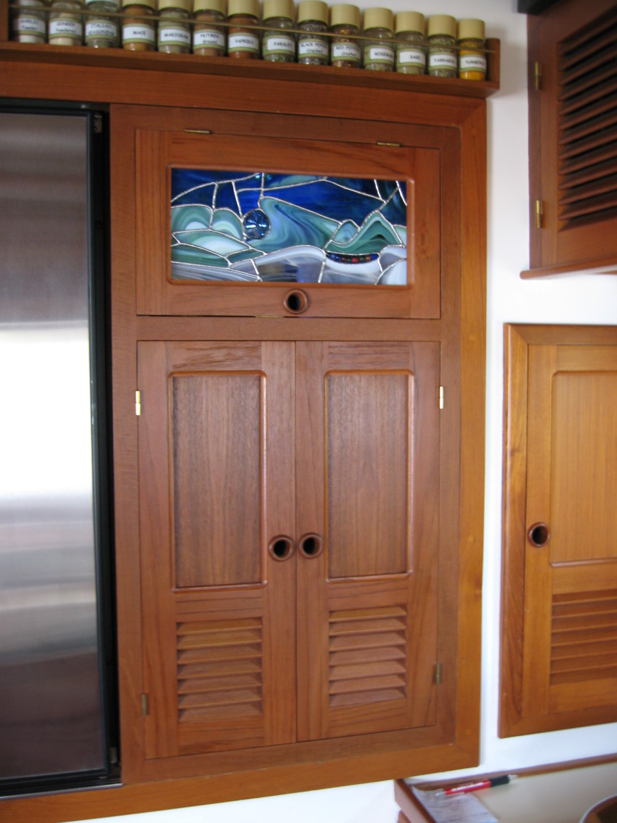 The replaced galley cupboard feature a stained glass window. One of many modifications.