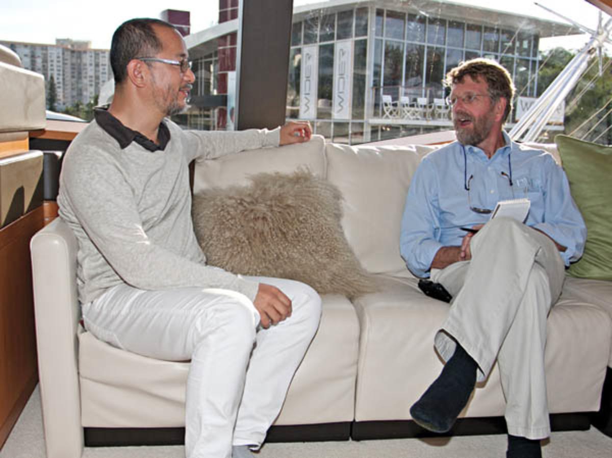 Nozawa and the author talk at the boat show in Miami Beach.