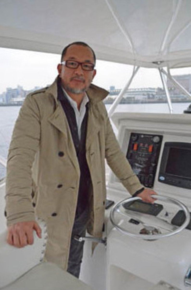 Nozawa standing at Golden Bay's helm after her refit was completed.