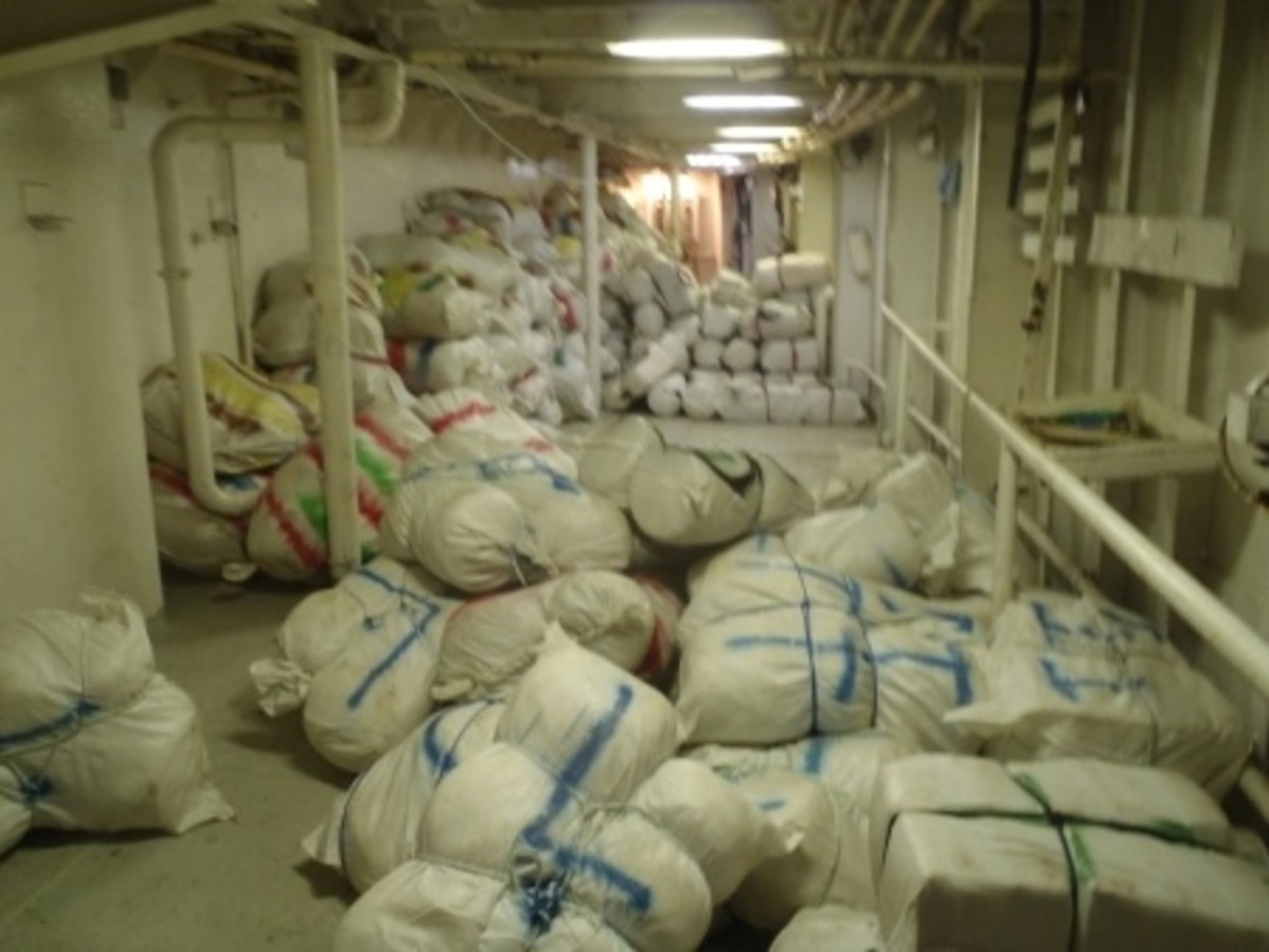 Thirteen thousand pounds of marijuana inside the cargo freighter Caribbean Soul were offloaded in Ponce, Puerto Rico, May 17, 2015, after Coast Guard, the Royal Netherlands Navy and U.S. law enforcement partner agencies seized the drug shipment.
