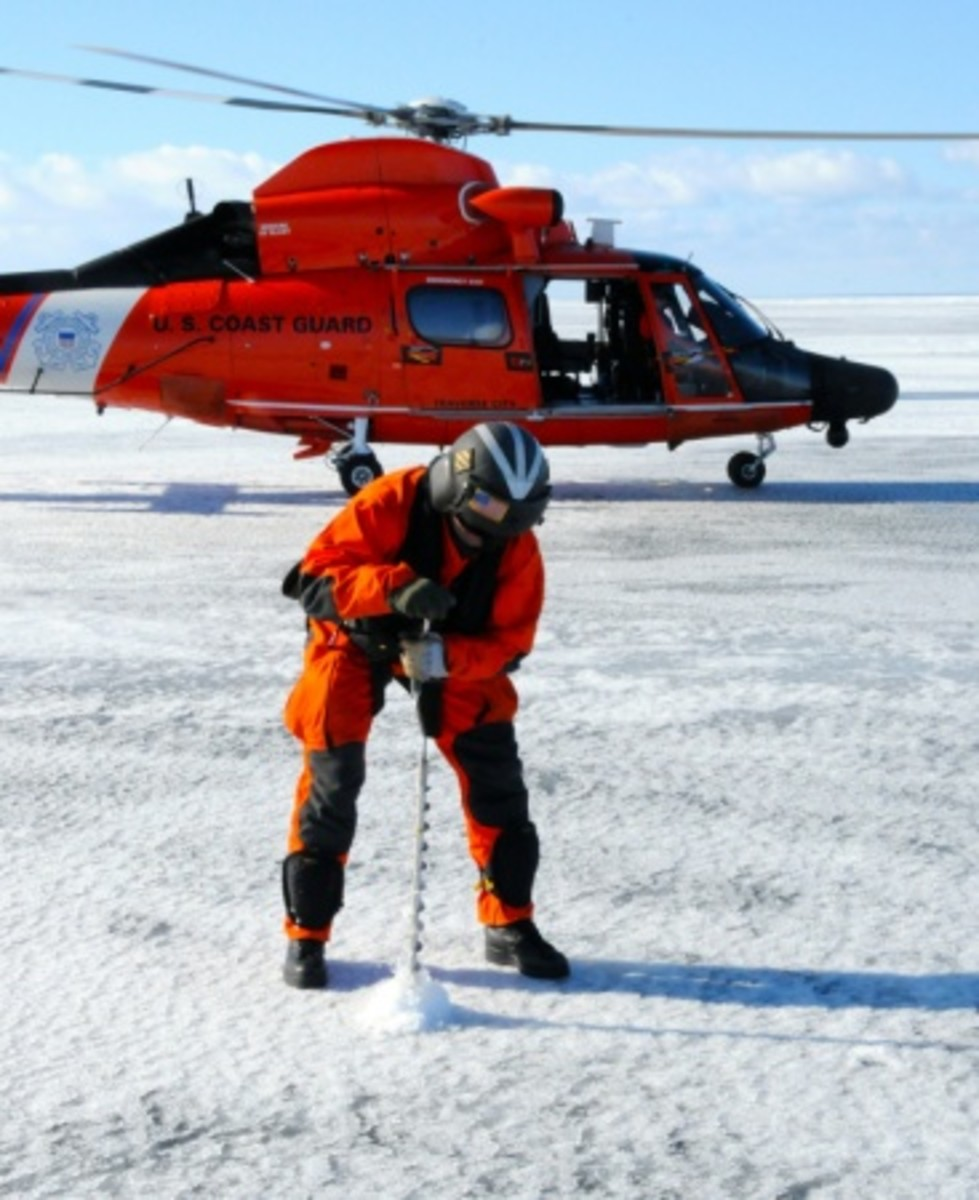 Coast Guard Petty Officer 1st Class Shawn Vandenberg, an aviation maintenance technician at Air Station Traverse City, Michigan, conducts ice thickness sampling in Lake Superior near Whitefish Point, Tuesday, March 17, 2015. The ice depth samples gathered will allow the U.S. and Canadian Coast Guard to plan ice breaking routes in support of the start of the shipping season. (U.S. Coast Guard photo by Petty Officer 2nd Class Alex Major)