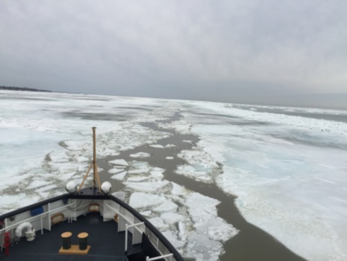 The crew of Coast Guard Cutter Neah Bay, a 140-foot ice breaking tug homeported in Cleveland, conducts ice breaking operations in Lake Erie near Vermilion, Ohio, to break up ice jams that are causing flooding further inland March 13, 2015. The crew encountered ice windrows 5 feet high on average, with some as high as 20 feet above the water. (U.S. Coast Guard photo by Seaman James Becker)