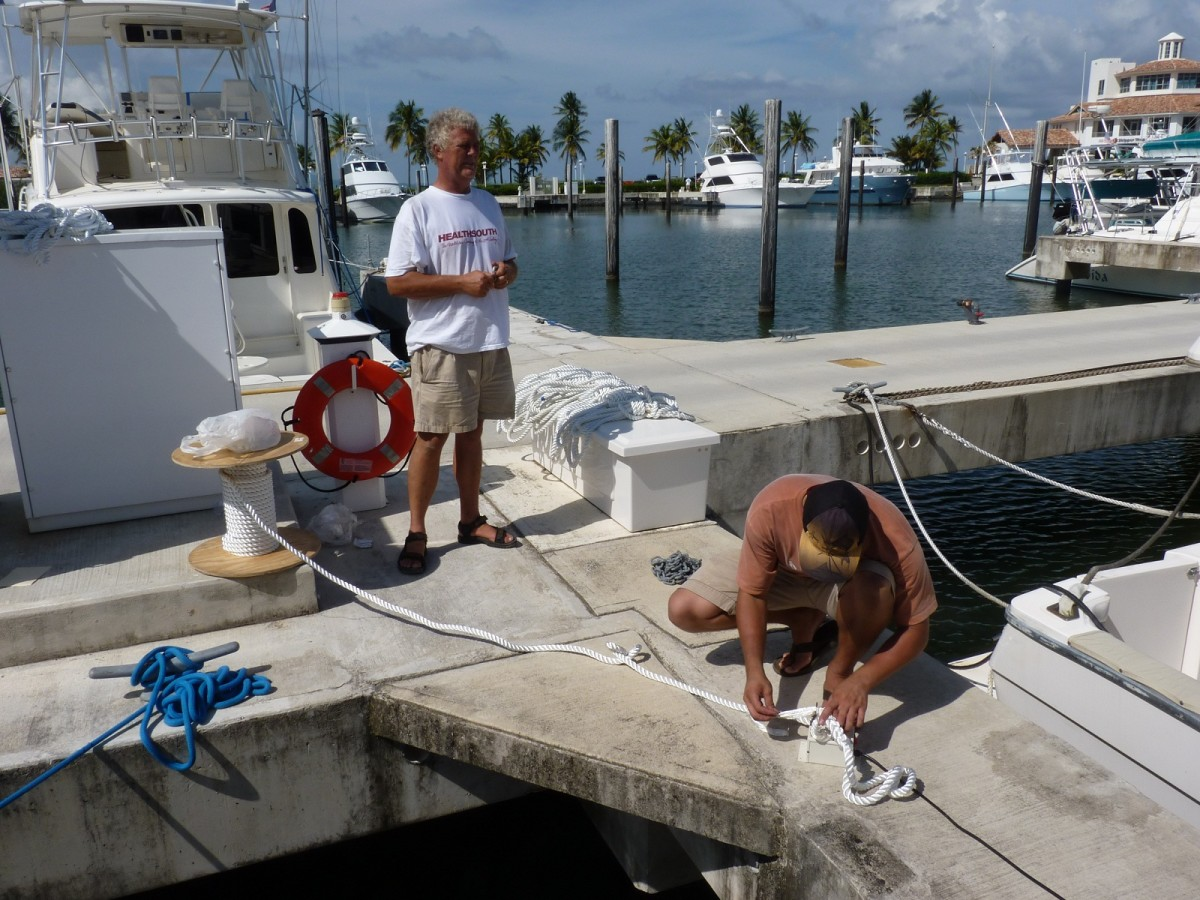 Bob and JJ measuring and splicing lines on the dock.
