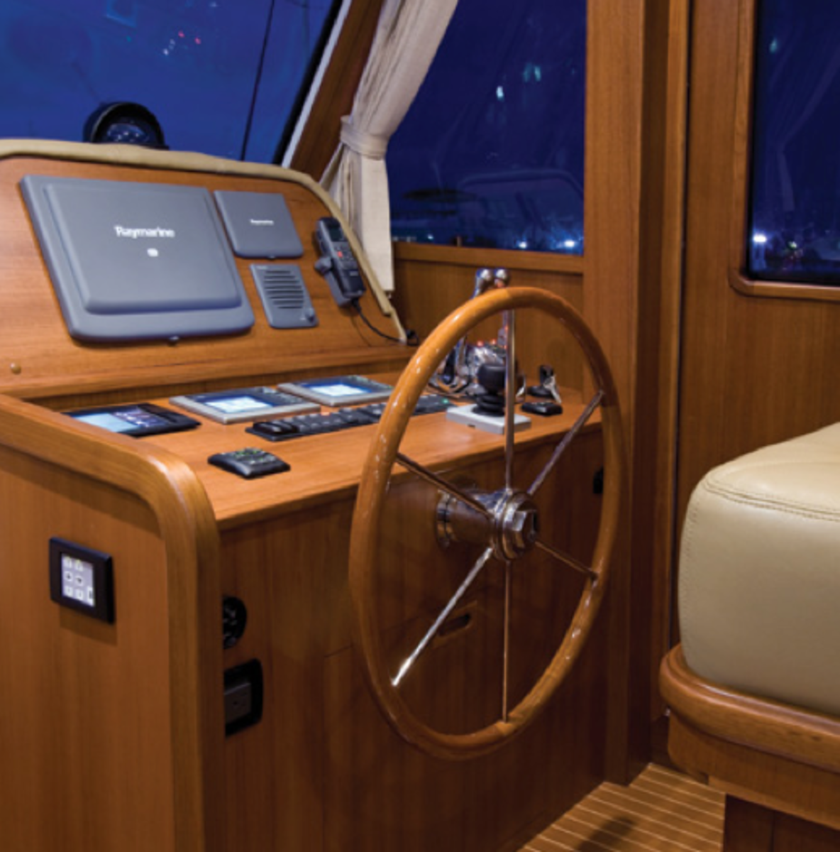 Joystick controls, yes, but also a wood and stainless ship's wheel, and the helm is an example of the near-perfect joinery throughout.