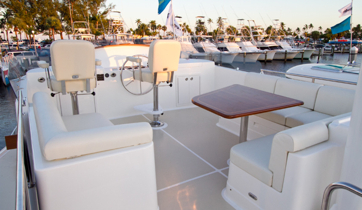 The flybridge features a standard helm seat at centerline with optional companion helm seats to port or starboard. A straight settee to port with a large L-settee to starboard surrounds the dining table to provide ample seating.