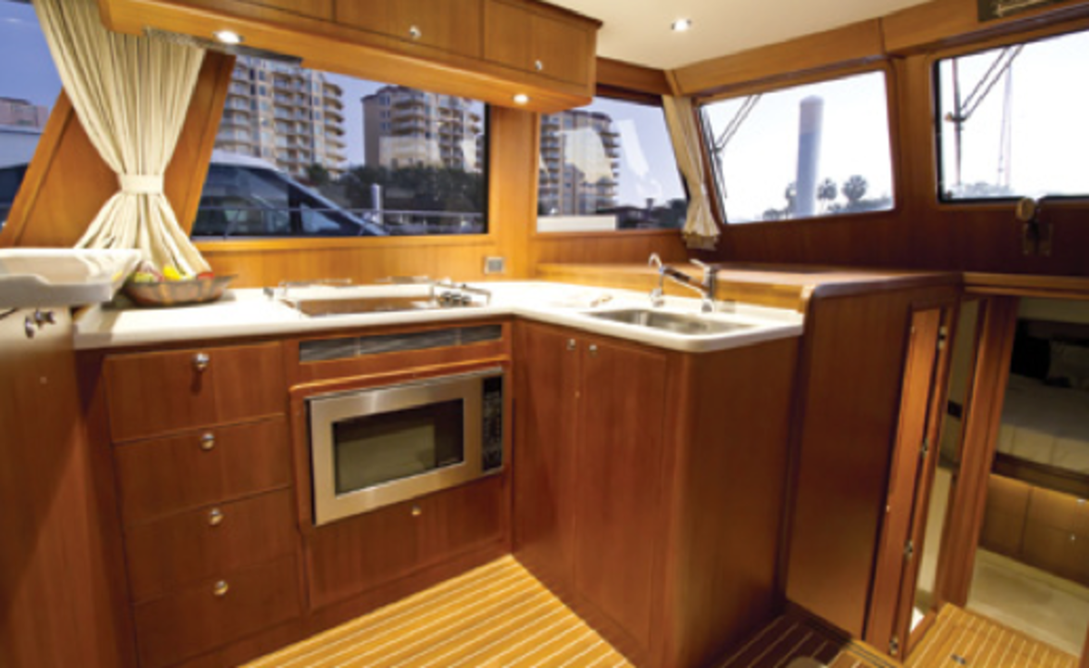 Buyers often insist on a galley-up design such as this one because it allows the cook to enjoy the view and socialize while preparing a meal.