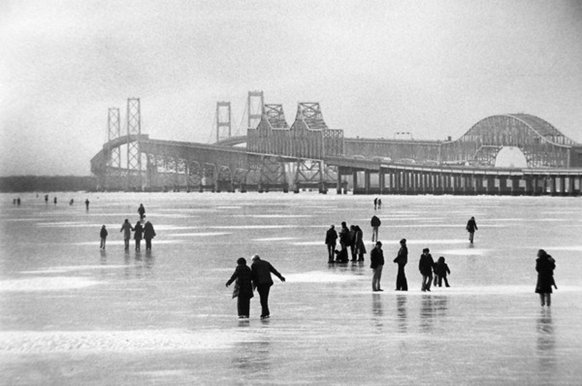 The Chesapeake Bay froze all the way across in areas during the winter of 1976-1977. Shown here are people checking out the ice by the Chesapeake Bay bridges. Photo courtesy of Baltimore or Less, photo taken by Bob Grieser