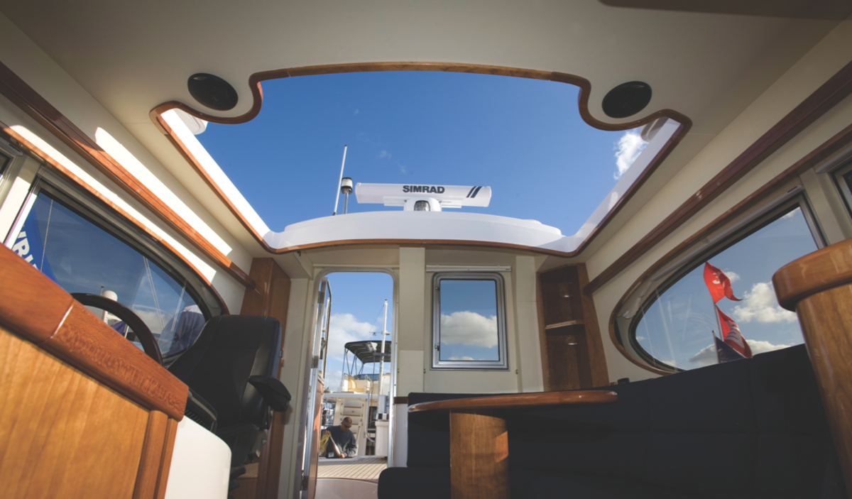 Deployable at the touch of a button, the retractable sunroof really opens up the helm and upper seating area.