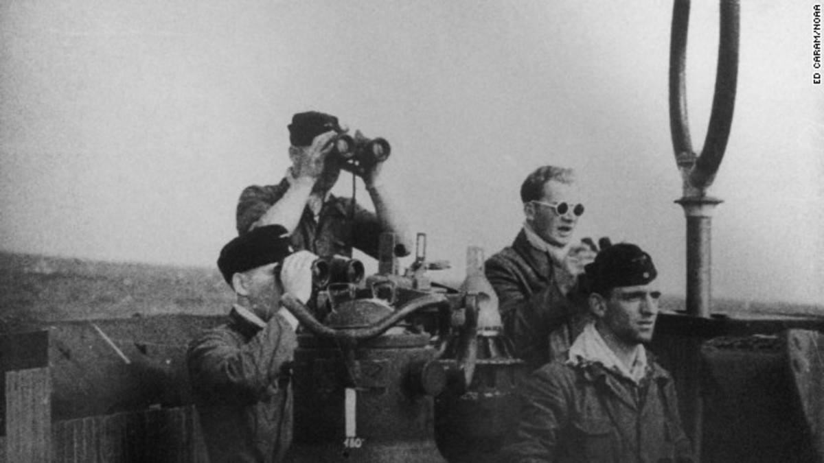 Crew members are seen in the sub's conning tower.