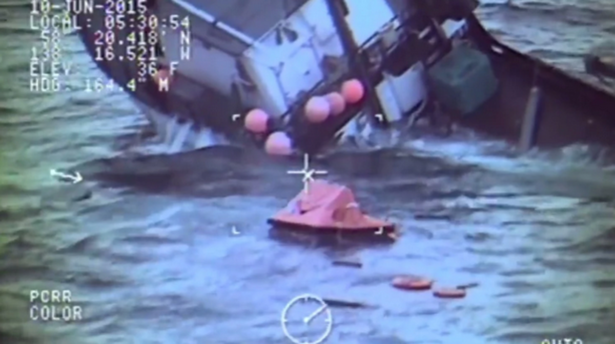The triangular shape near center is the life raft deployed by the fishing crew. At first, responders feared rough conditions would force the raft into the wreckage.