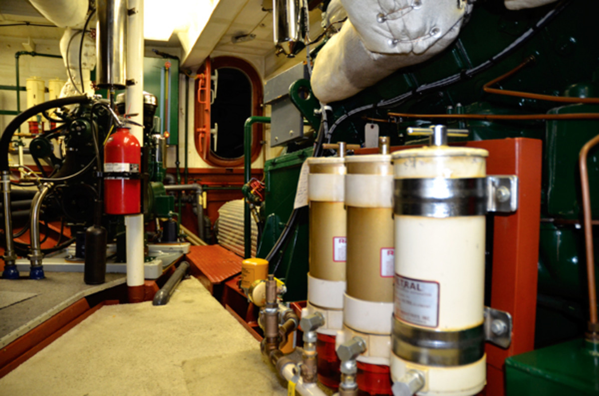 The converted tug Island Ranger sports an impeccable engine room, making maintenance far easier. Note the three Racor fuel-water separators on the right side of the photo.