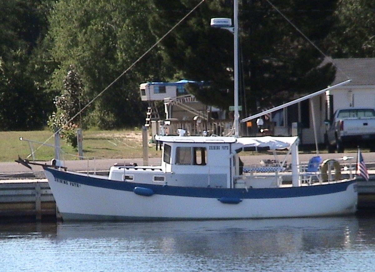 "Before: Shining Path in her previous incarnation—original ""sail option"" still intact—docked on the South Shore of Lake Superior's Keweenaw Peninsula. (Photo courtesy John Hulkoff)"