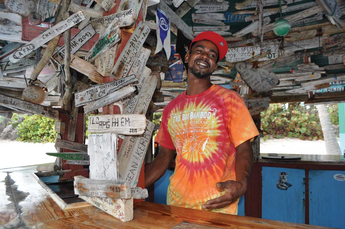 The bartender at the (world famous) Big Bamboo beach bar satisfies his customers' thirst for entertainment as well as rum drinks.