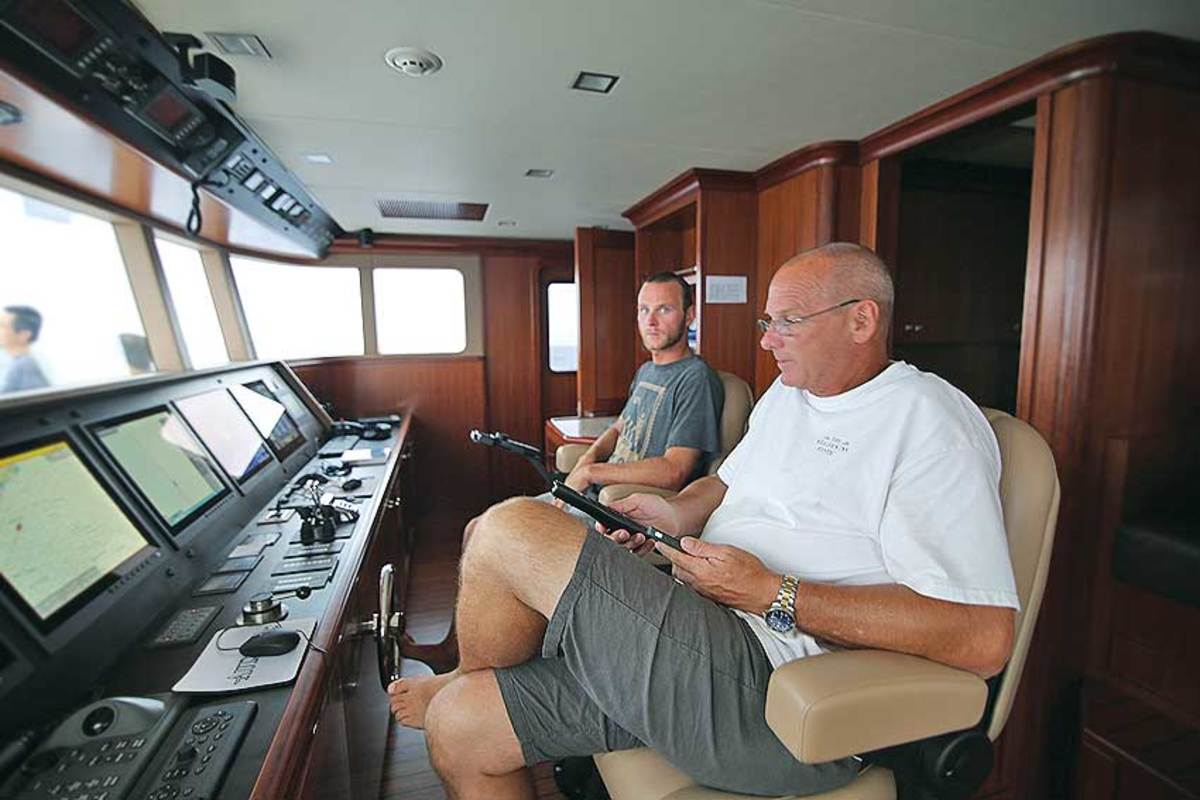 Brett and Jeff Leishman stand watch on the bridge of the Nordhavn 120. Jeff Leishman is Nordhavn's lead designer.