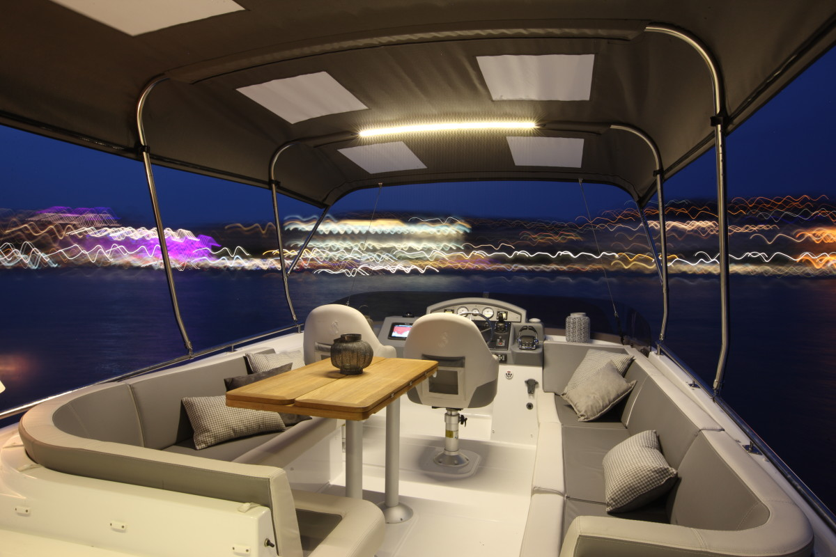 A spacious flybridge combines a center helm and comfortable seating for eight adults.