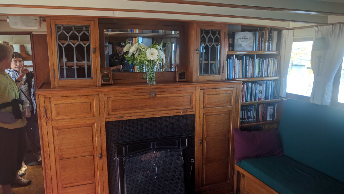 The fireplace in the salon of the MV Westward.  The bookshelf at right is a more recent addition replacing the original gun cabinet.