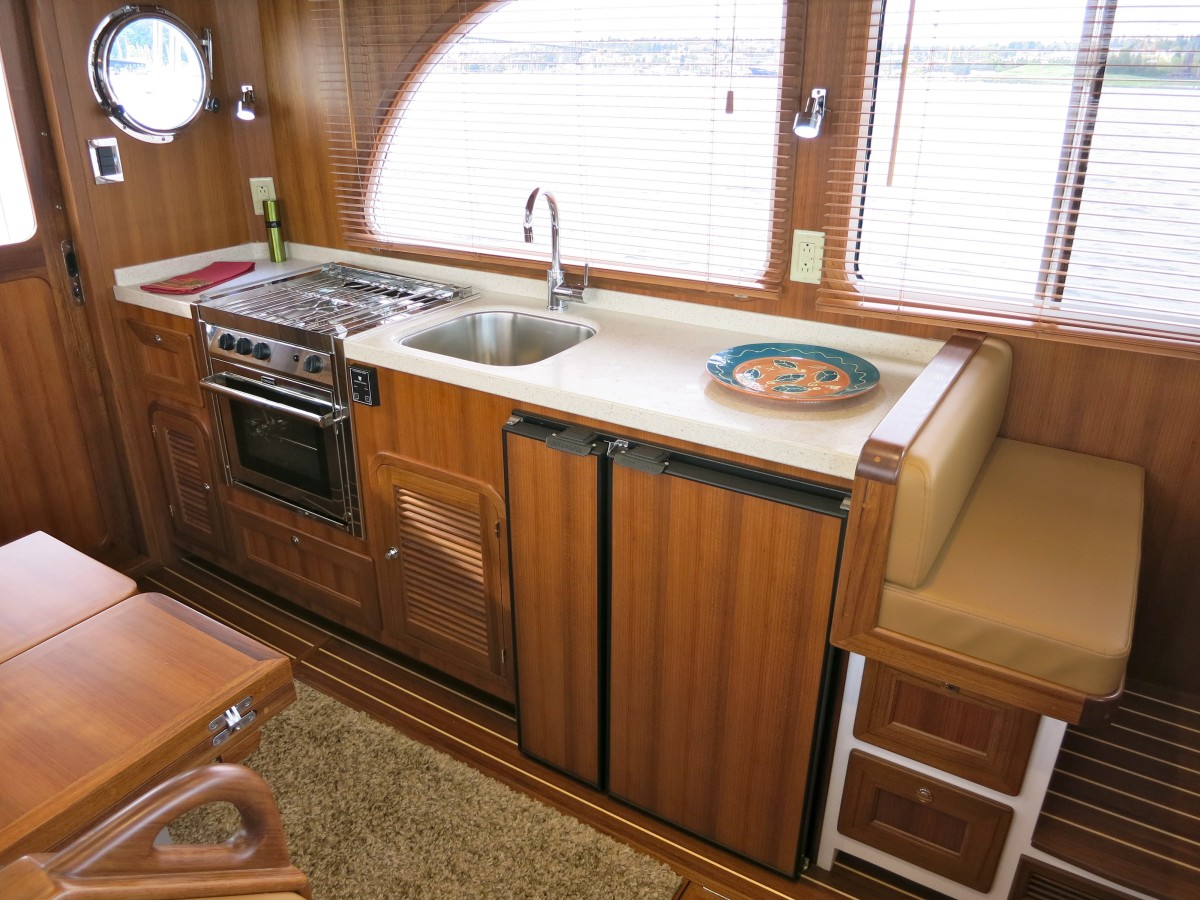 Well designed Euro-style galley with amazing overhead storage (not seen here).