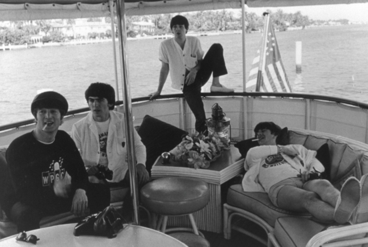 The Beatles ride in a motoryacht in South Florida. Was urbanite Paul McCartney catching the cruising bug?