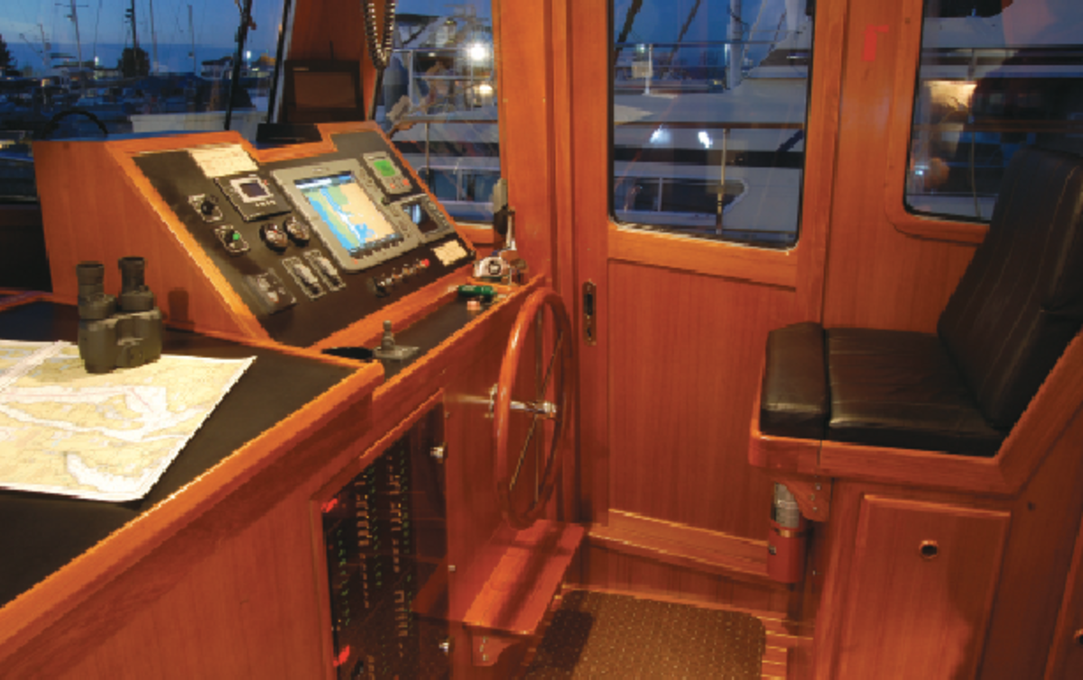 Port-and-starboard pilothouse doors open directly to boarding gates for immediate access when approaching an alongside tie.